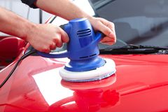 Auto polisher. Hands with Auto polisher. Car repair service Royalty Free Stock Image