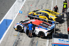Auto racing pit lane activity Royalty Free Stock Photos
