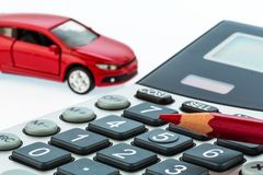 Auto, red pen and calculator. A car and a red pen is on a calculator. cost of gasoline, wear and insurance. car costs are not paid by commuter tax royalty free stock photo