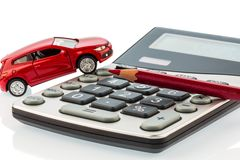 Auto, red pencil and calculator. A car and a red pen is on a calculator. cost of gasoline, wear and insurance. car costs are not paid by commuter tax royalty free stock image