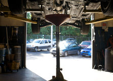 Auto repair. Series shots of Cars at an auto repair shop. Details of parts exposed Stock Image
