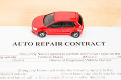 Auto Repair Contract With Red Car on Center Royalty Free Stock Photography