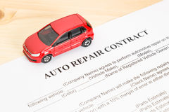 Auto Repair Contract With Red Car on Left View Stock Photography