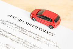 Auto Repair Contract With Red Car on Right View Stock Images