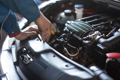 Auto repair service. Car mechanic working in auto repair service Stock Photo