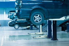 Auto repair shop. Cars up on lifts in an auto repair shop Stock Images