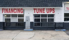 Auto repair shop bays financing tune ups deal. Auto repair shop bays shade tree mechanic deals financing tune ups deal Royalty Free Stock Photography