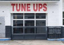 Auto repair shop bays tune ups. Auto repair shop bays shade tree mechanic deals tune ups Stock Image