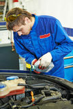 Auto repairman at work Royalty Free Stock Images