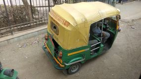 Auto rickshaw. A auto rickshaw advertising government added for women's helpline numbers in india Stock Image
