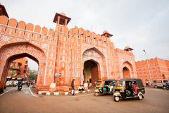 Auto rickshaw drive fast near the old gates of historical Pink City Stock Photo