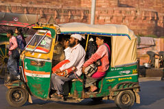 Auto rickshaw driving on road,India stock photos