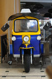 An auto rickshaw parked indoors Royalty Free Stock Image