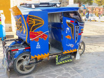 Auto rickshaw parked in the street of Chivay town, Peru Royalty Free Stock Images