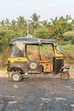 Auto rickshaw seen from the side, tuk-tuk on the road, Hampi royalty free stock photography