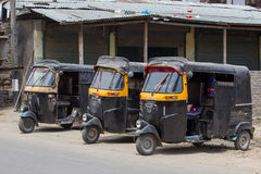 Auto rickshaw taxi on a road in Srinagar, Kashmir, India. Royalty Free Stock Images