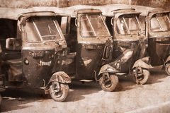 Auto rickshaw taxis in Agra, India. Artwork in retro style. Royalty Free Stock Photography