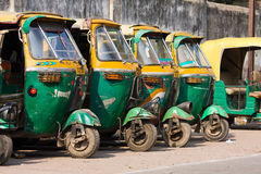Auto rickshaw taxis on a road in Agra, India. Royalty Free Stock Image