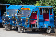 Auto rickshaw taxis on a road. India Royalty Free Stock Image