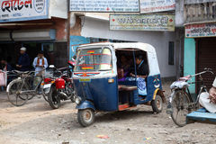 Auto rickshaw taxis on a road in Kumrokhali, West Bengal January 12, 2009. Typical mileage Stock Photos