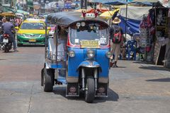 Auto rickshaw or tuk-tuk on the street of Bangkok, Thailand. Tuk tuks are commonly used in transporting people and goods around th Stock Photo