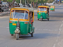 Auto Rickshaws on the Road in Delhi Royalty Free Stock Image