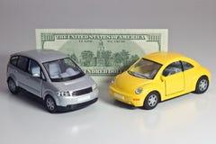 Auto's en geld Stock Foto