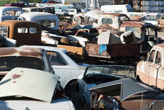 Auto Salvage Yard. Old vehicles in an auto salvage yard being recycled for parts and scrap metal Stock Image