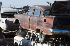 Auto Salvage Yard. Old vehicles in an auto salvage yard being recycled for parts and scrap metal Royalty Free Stock Photography