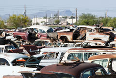 Auto Salvage Yard. Old vehicles in an auto salvage yard being recycled for parts and scrap metal Stock Images
