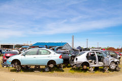 Auto Salvage Yard Junkyard. The scene shows many cars and other automobiles in a salvage junk yard where customers can pick and choose part for their vehicle Stock Photography