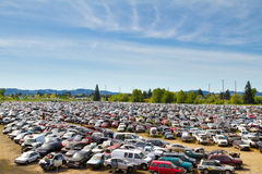 Auto Salvage Yard Junkyard. The scene shows many cars and other automobiles in a salvage junk yard where customers can pick and choose part for their vehicle Royalty Free Stock Photography