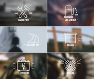 Auto service badges on a blurred backgrounds Stock Photo