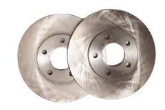 Auto service. Brake disks for modern car isolated. Auto in service. Closeup of new brake disks for modern car isolated on white. By machinist Royalty Free Stock Photo