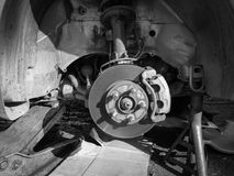 Disc brakes Service car. Auto Service car disc brakes changing of lifted automobile at auto repair garage shop station Stock Photos