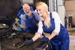 Auto service center crew near car Stock Photography