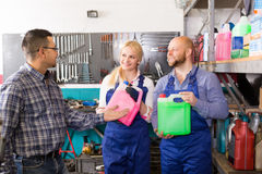 Auto service crew with canisters Royalty Free Stock Image