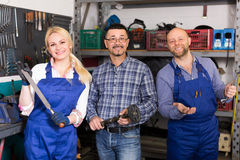 Auto service crew near tools Royalty Free Stock Image