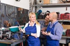 Auto service crew near tools Stock Photography