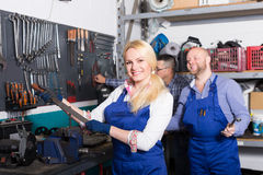 Auto service crew near tools Stock Photo