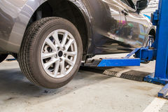 Auto service garage with car at lift Royalty Free Stock Images
