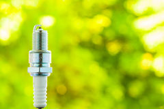 Auto service. New spark plug as spare part of car. Stock Photos