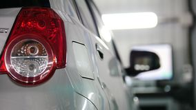 Auto service - red backlights of white car, transportation concept. Close up stock video footage