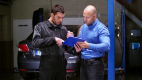 Mechanic and customer shaking hands at car service stock video