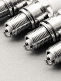 Auto service. Set of spark plugs as spare part of car. Stock Photography