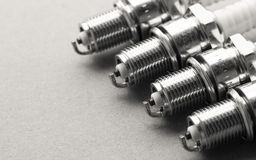 Auto service. Set of spark plugs as spare part of car. royalty free stock photo