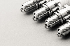 Auto service. Set of spark plugs as spare part of car. Stock Photo