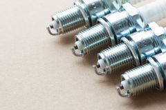 Auto service. Set of spark plugs as spare part of car. Stock Images