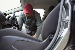 Auto service staff cleaning car interior. Male auto service staff cleaning car interior Stock Photo
