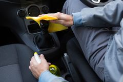 Auto service staff cleaning car interior Royalty Free Stock Photography
